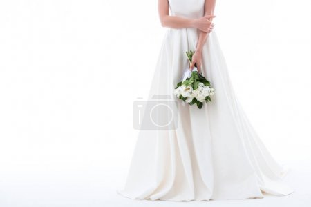 cropped view of elegant girl in wedding dress with bouquet, isolated on white