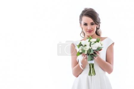 brunette bride posing with wedding bouquet, isolated on white
