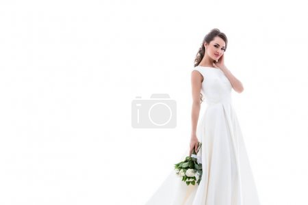 smiling bride posing in traditional white dress with wedding bouquet, isolated on white