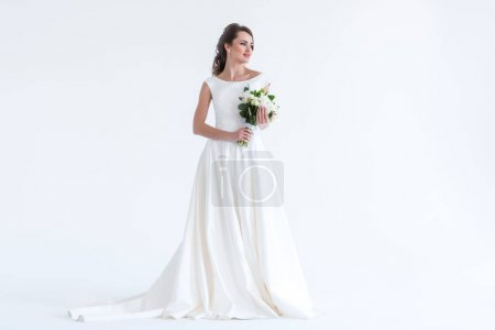 beautiful brunette bride posing in white dress with wedding bouquet, isolated on white
