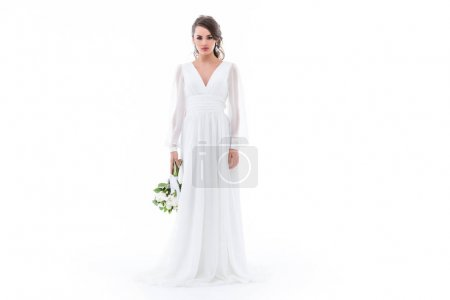 caucasian bride posing in elegant white dress with wedding bouquet, isolated on white