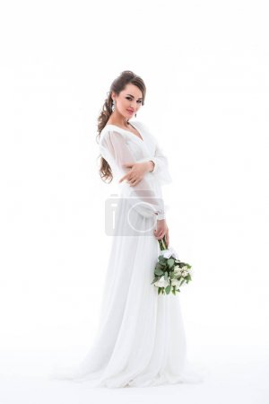 smiling bride posing in white dress with wedding bouquet, isolated on white