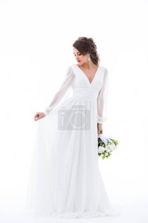 brunette bride posing in elegant white dress with wedding bouquet, isolated on white