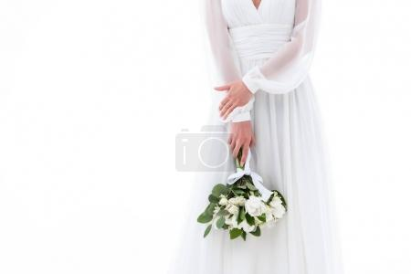 cropped view of bride in elegant dress with wedding bouquet, isolated on white