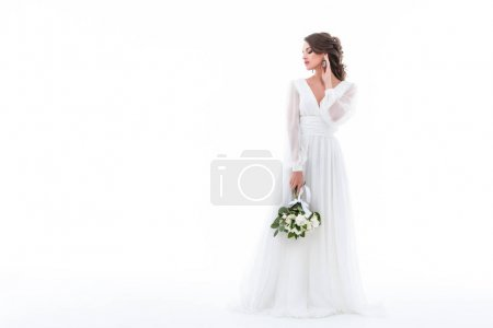 Photo for Bride posing in elegant white dress with wedding bouquet, isolated on white - Royalty Free Image