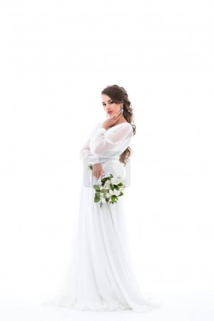 elegant bride posing in white dress with wedding bouquet, isolated on white