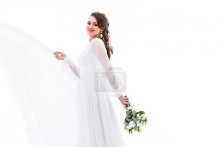happy beautiful bride posing in white dress with wedding bouquet, isolated on white