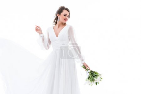happy bride posing in traditional dress with wedding bouquet, isolated on white