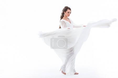 beautiful elegant bride dancing in wedding dress, isolated on white