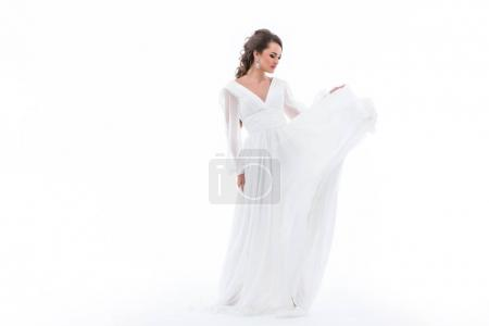 elegant bride in traditional white dress, isolated on white