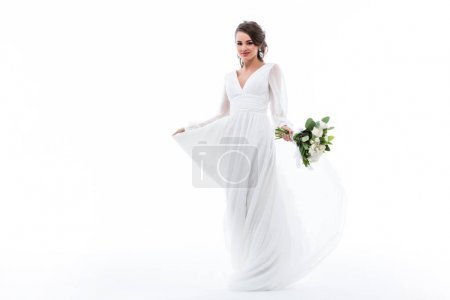 attractive bride posing in white dress with wedding bouquet, isolated on white