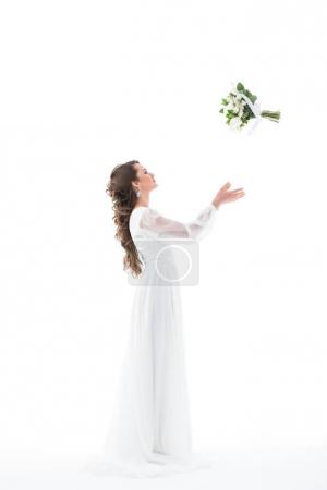 brunette bride in white dress throwing wedding bouquet, isolated on white