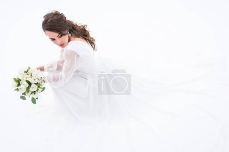 brunette bride in traditional elegant dress holding wedding bouquet, isolated on white