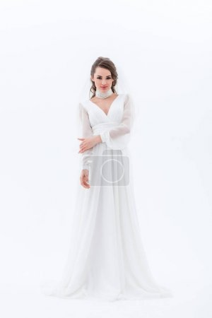 beautiful smiling bride posing in traditional wedding dress, isolated on white