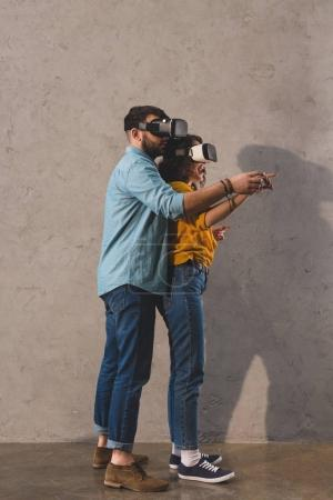 Couple standing and using virtual reality headset