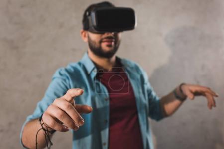 Smiling man using virtual reality headset