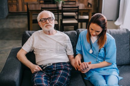 Medical worker checking heartbeat of senior man