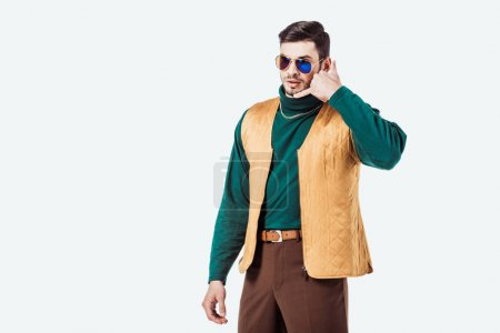 handsome retro styled man pretending talking by telephone isolated on white