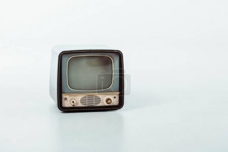 old small vintage television on white