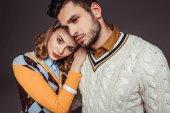 beautiful retro styled couple hugging isolated on grey