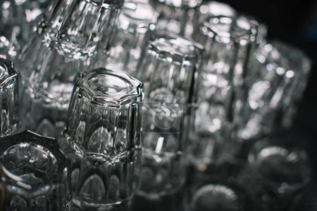 clean empty glasses for drinks on pile