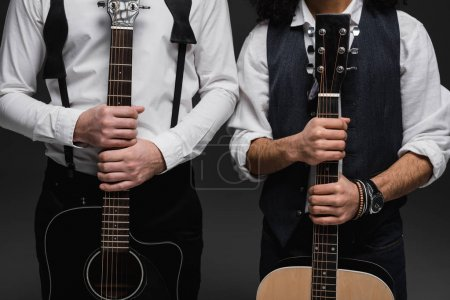 Photo for Cropped shot of duet of musicians with acoustic guitars - Royalty Free Image