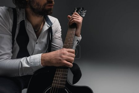 Photo for Cropped shot fo musician with acoustic guitar - Royalty Free Image