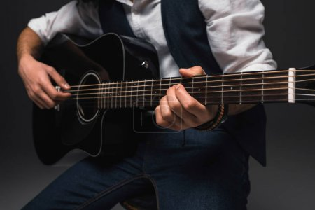 Photo for Cropped shot of man playing acoustic guitar - Royalty Free Image