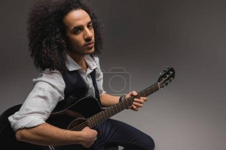 Photo for Young african american musician playing acoustic guitar - Royalty Free Image