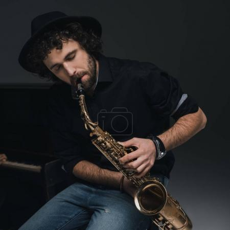 Photo for Handsome young musician playing saxophone - Royalty Free Image