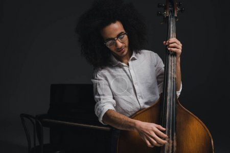 Photo for Happy young musician playing standup bass - Royalty Free Image