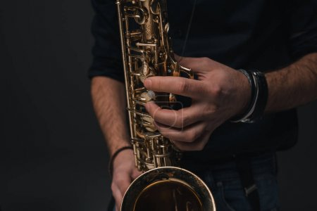 Photo for Cropped shot of jazz musician playing saxophone - Royalty Free Image