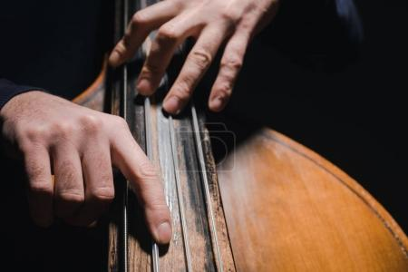 Photo for Cropped shot of man playing bass violoncello - Royalty Free Image