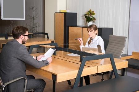 Business colleagues having discussion in office