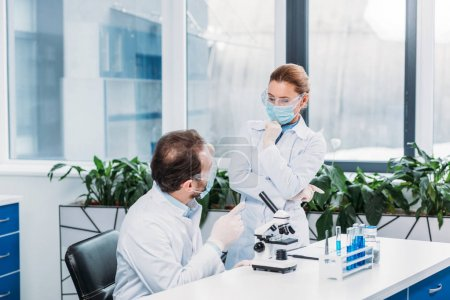 Photo for Scientists having discussion at workplace in laboratory - Royalty Free Image