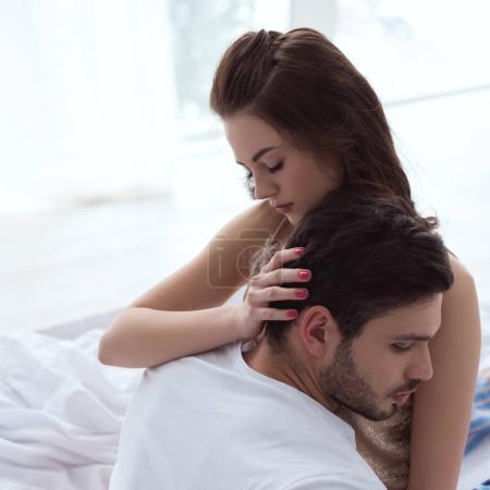 tender woman hugging boyfriend at home