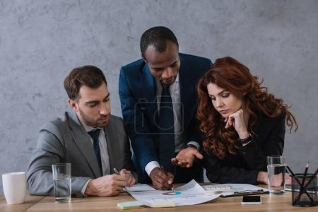 Photo for Investment adviser showing presentation to business partners - Royalty Free Image