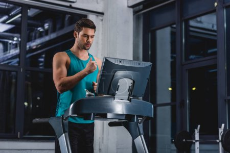 sportsman doing cardio training on treadmill in gym