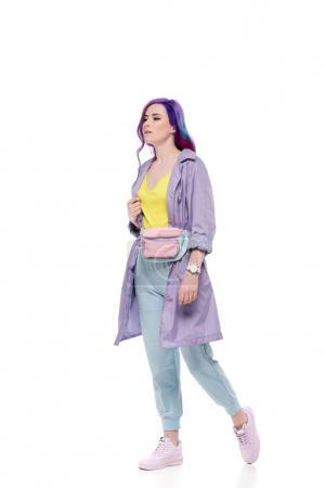 stylish young woman in purple trench coat with waist pack isolated on white