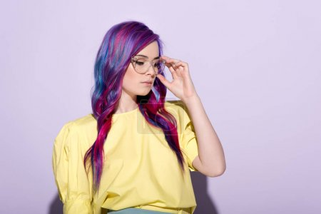 sensual young woman with colorful hair and stylish eyeglasses on pink