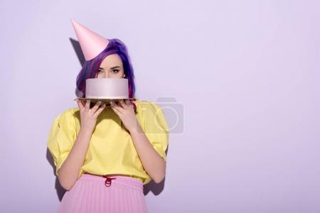 Photo for Attractive young woman with colorful hair covering face with birthday cake - Royalty Free Image