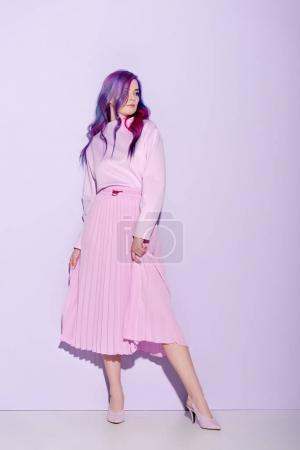 attractive young woman with colorful hair on pink