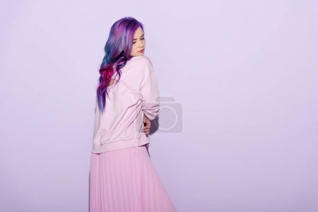 beautiful young woman with colorful hair on pink