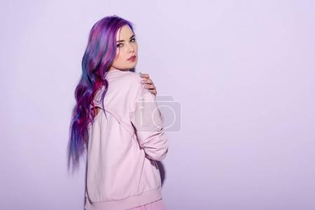 sensual young woman with purple hair on pink