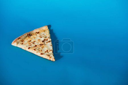 close up view of piece of italian pizza isolated on blue