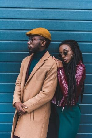 beautiful stylish young african american couple in fashionable outfit posing together outside