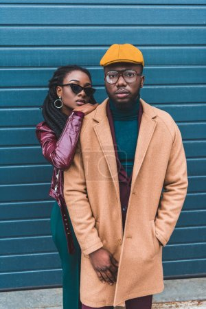stylish young african american couple looking at camera while posing together on street
