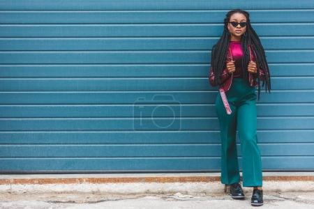 Photo for Full length view of beautiful stylish young african american woman looking at camera - Royalty Free Image