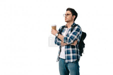 Photo for Handsome student holding coffee in paper cup and looking away isolated on white - Royalty Free Image