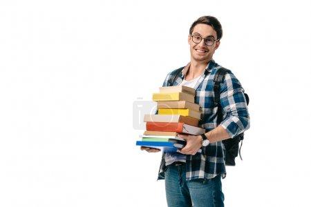 Photo pour Sourire beau étudiant tenant pile de livres isolés sur blanc - image libre de droit